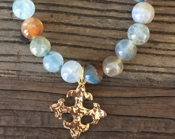 10mm Blue fire agate beaded bracelet with Hammered gold plated cross fleury relic