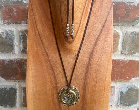 "The ""Harper"" 34"" Bronze double horn pendent on leather with metal accents"