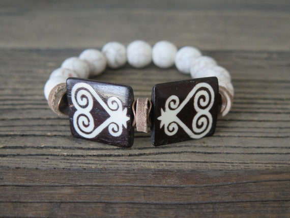 "Hand beaded 12mm matte howlite bracelet accented with Ox bone ""heart"" beads"