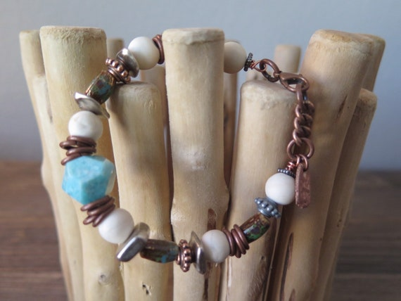 "8"" Hand beaded Natural howlite and metal bracelet."