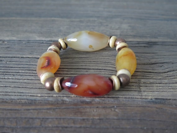 Hand beaded Carnelian bracelet accented with vintage copper and leather findings