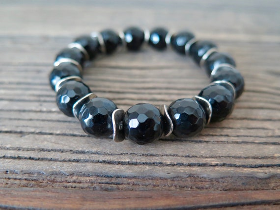 12mm hand beaded Black Onyx bracelet accented with silver plated findings