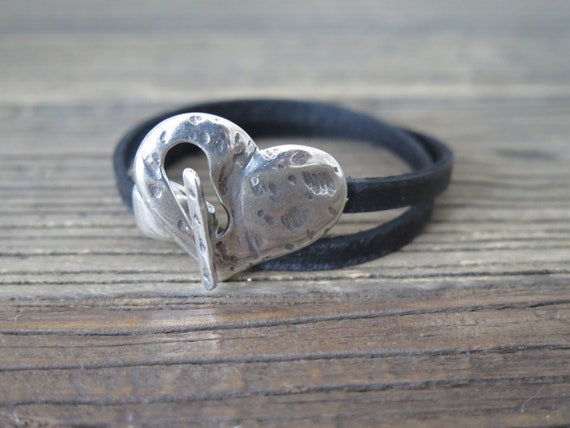 "15 1/2"" double wrap black vintage leather cuff accented with a silver plated heart buckle"