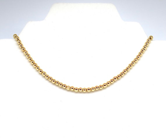 """The """"Cara"""" 15"""" 18k gold filled 4mm bead choker with 2"""" extender."""