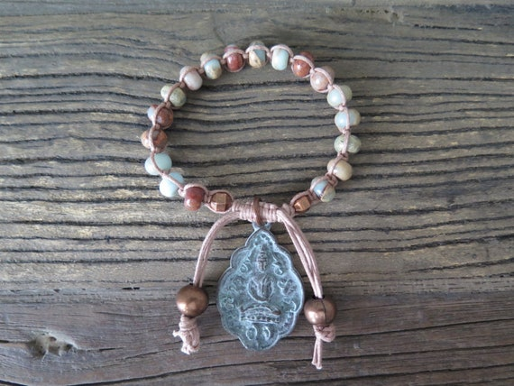 Hand beaded African Opal Shambahla bracelet accented with a Buddha Amulet.