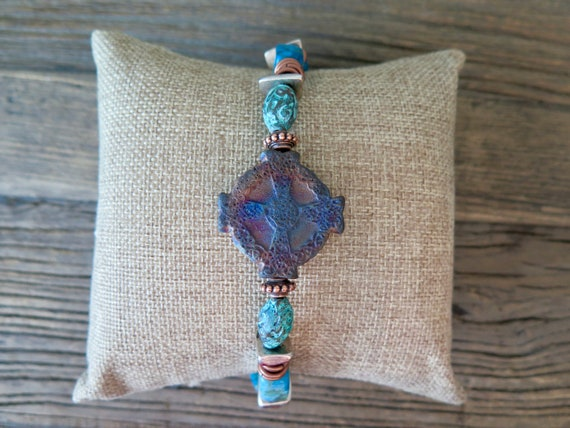 "The ""Delilah"" 8"" hand beaded bracelet accented with a Patinaed Cross Relic and Jasper and metal beads"