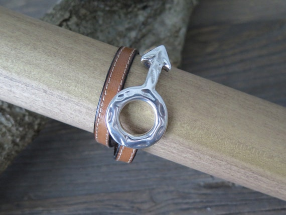 "15"" 10mm hand made double wrap European leather cuff bracelet accented with a silver plated Mars ""Male"" symbol buckle"
