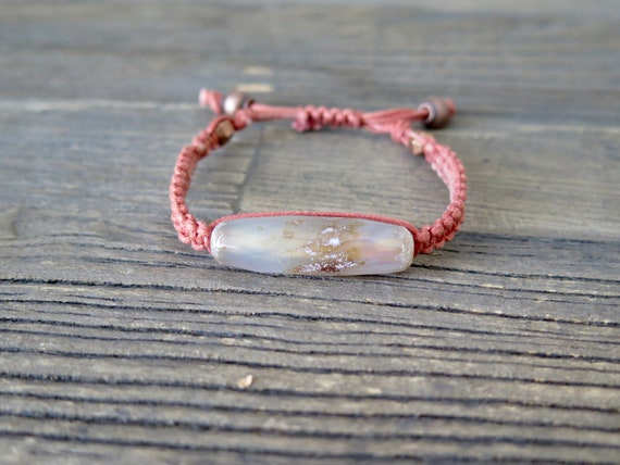 "6 1/2"" Hand woven Salmon colored Shambahla bracelet accented with a Striped Agate center."