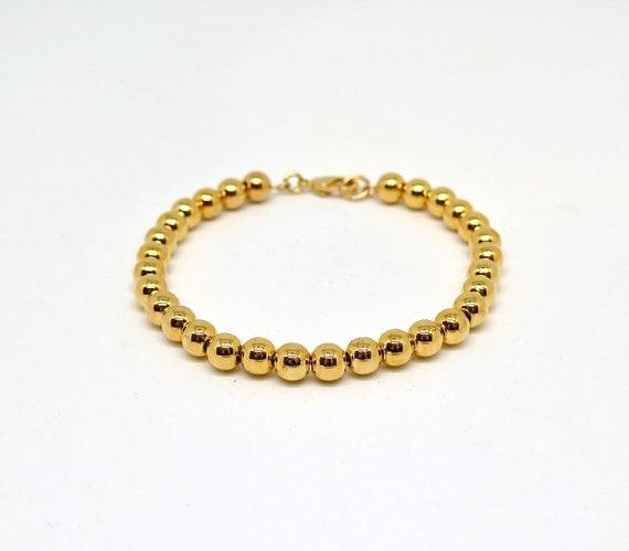 """7 1/2"""" hand beaded 14k gold filled bracelet"""