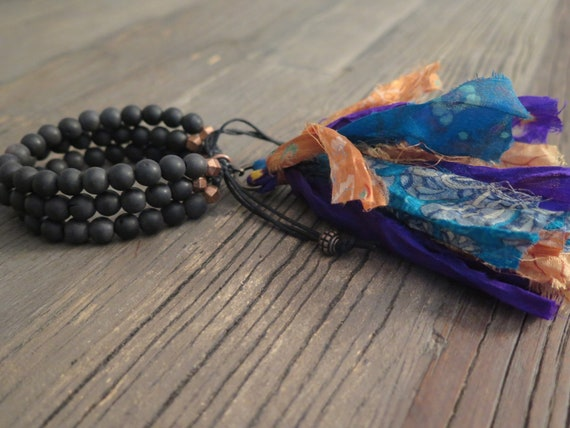 Hand beaded 8mm triple black matte agate Shambahla bracelet accented with a Sari silk tassel