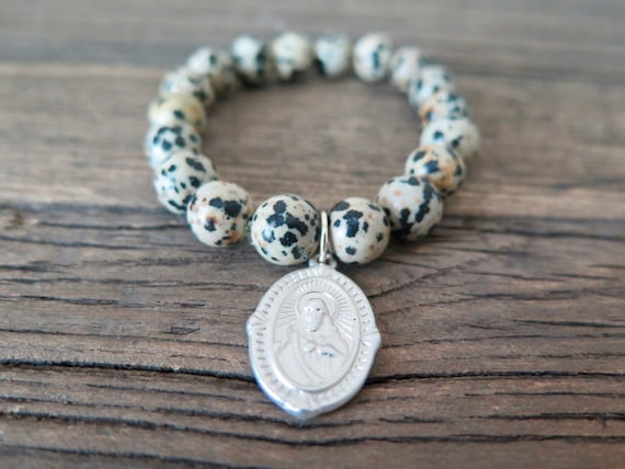 10mm hand beaded Dalmation Jasper bracelet with silver plated religious charm