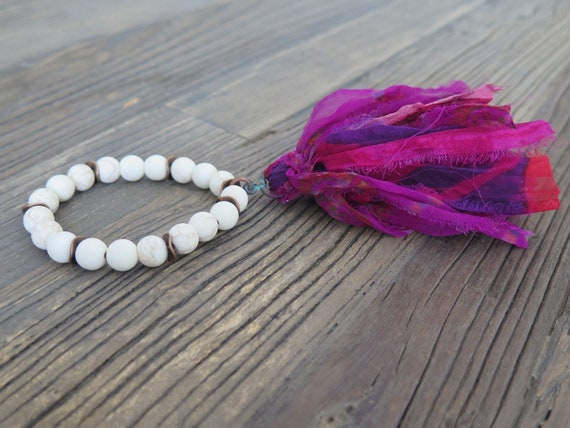 Hand beaded 10mm matte natural Howlite bracelet accented with a Sari Silk Tassel