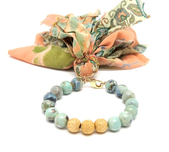 """7 1/2"""" hand beaded Mongolian Turquoise on 14k gold filled chain accented with a Sari silk tassel"""