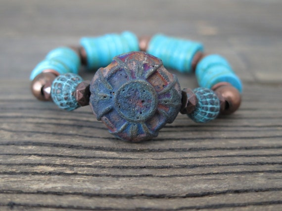 Turquoise heishi beaded bracelet accented with a ceramic relec and vintage findings