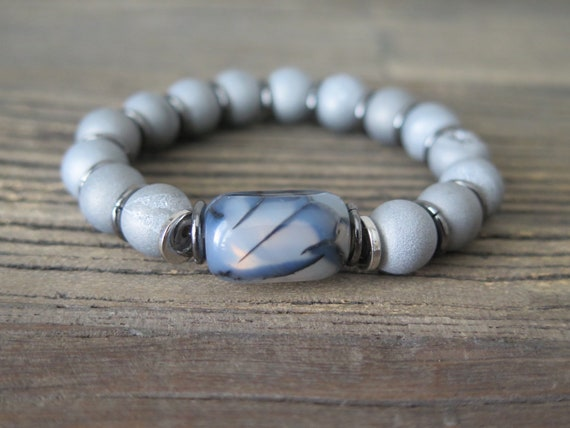 10mm hand beaded matte Druzy bracelet accented with a Dragon Vein Agate center piece.