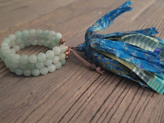 Hand beaded 8mm triple matte Aventurine Shambahla bracelet accented with a Sari silk tassel
