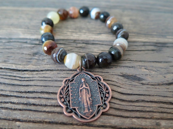 10mm hand beaded Brown striped Agate bracelet accented with a copper Relic charm