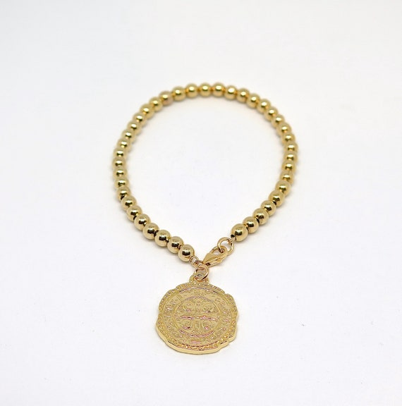 """7 1/2"""" 14k gold filled beaded bracelet with coin relec charm"""