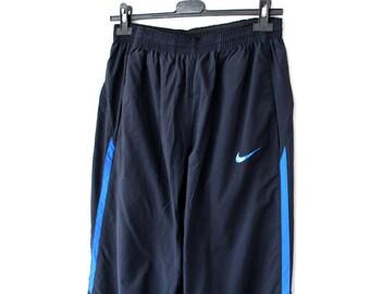 the latest 568f0 16aa7 90s Vintage NIKE Pants, Blue Nike Windbreaker, Nike Jogging Pants, Nike  Trousers, Nike Track Bottoms, Nike Swoosh, Nike Running Pants Size M
