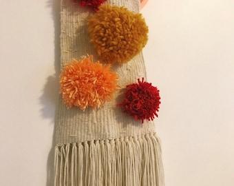 sheela woven wall hanging