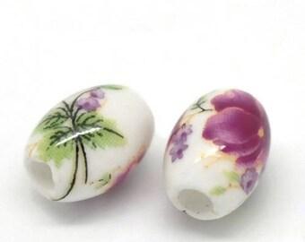 10 beads oval porcelain/ceramic 1.05 x 0.8 cm flower FUSCHIA