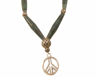 Blueish green multicolred necklace with peace sign charm
