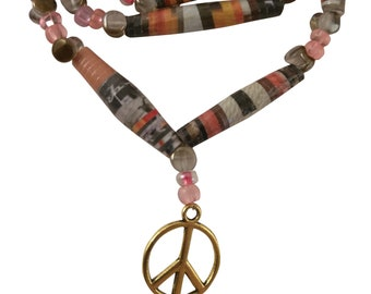 Mulitcolored orange, black, and pink paper bead necklace with golden peace sign charm