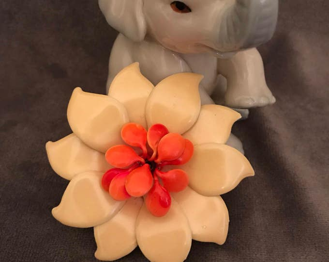 Vintage lucite yellow and coral colored flower