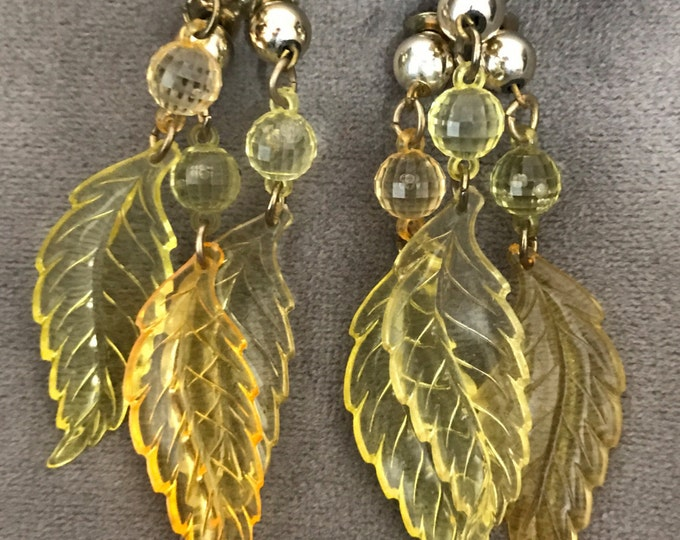 Vintage pierced yellow lucite, dangle and drop leaf earrings