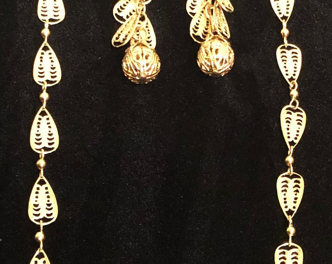 Trifari TM gold plated necklace with drop and dangling clip earrings