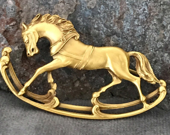 Vintage gold tone rocking horse pin, marked P&E.