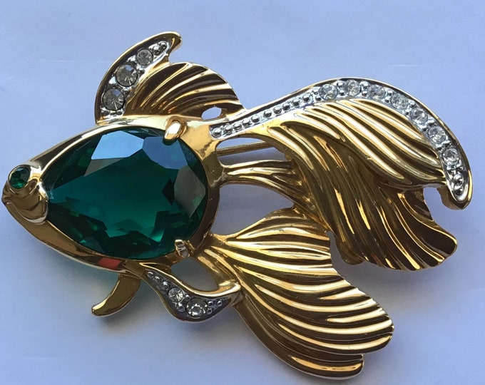 Gold plated japanese fighting fish with emerald glass belly