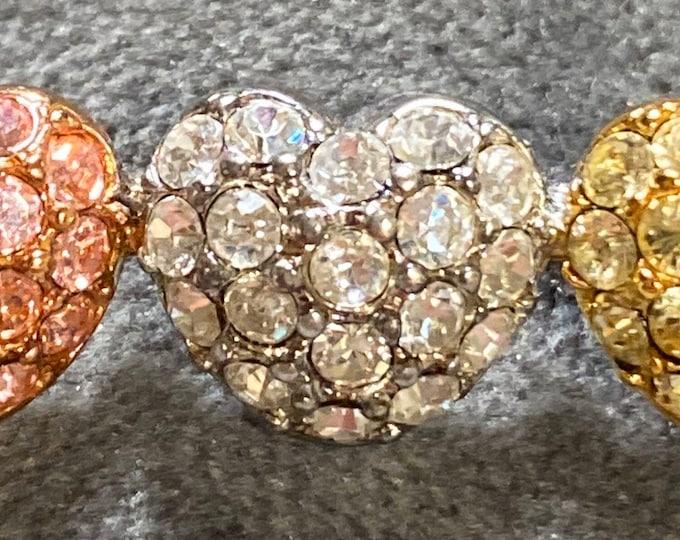 Monet three crystal heart pin