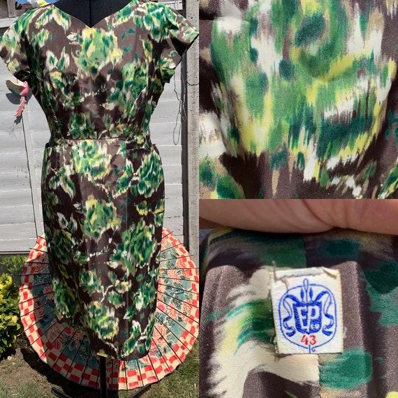 Green goddess!  Stunning 1950s wiggle dress.