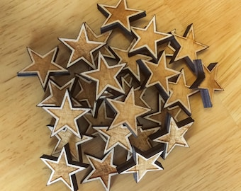 50 one inch rustic wood stars with a border