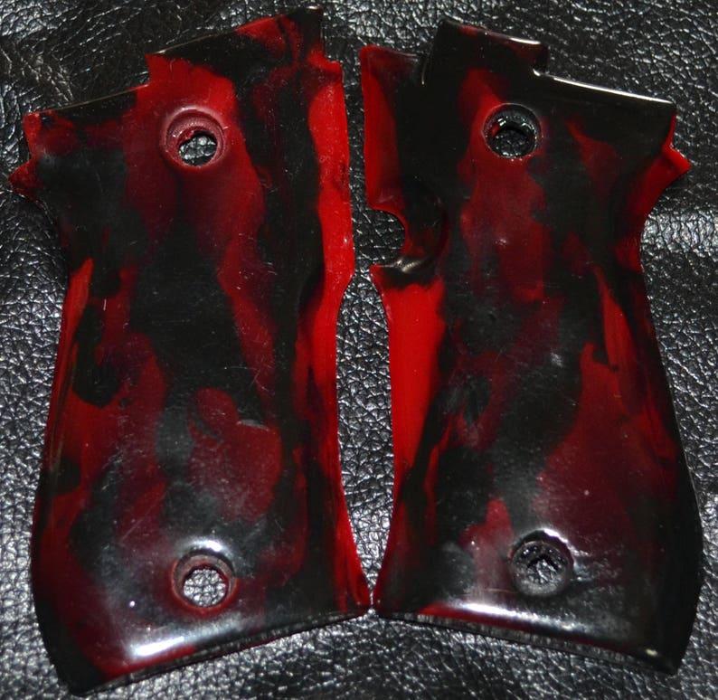 Beretta 85 BB pistol red and black swirl plastic