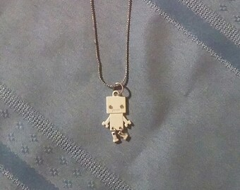 A White Robot on a Silver Necklace