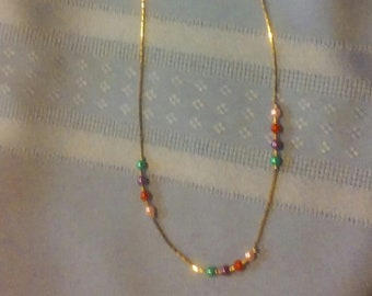 A Multi-Color Gold Avon Necklace