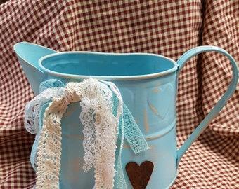 Metal decorative shabby pitcher