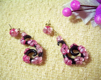 Earrings with black swirls and little flowers decoration made of cold porcelain
