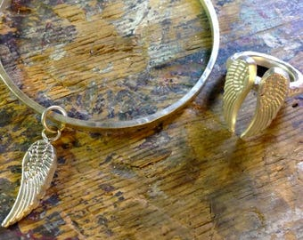 Solid silver personalisedsingle angel wing bangleand matching solid silver double wing ring.