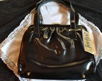 Jaclyn Black faux leather purse handbag