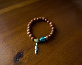 Turquoise skull wooden bead bracelet