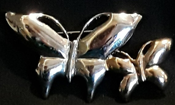 Vintage Brooch Pin of 2 butterflies one silver and one gold