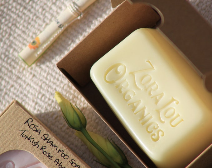 Organic shampoo and conditioning hair and body wash soap bar with evergreen Rosemary and light energising Lemongrass and Aloe Vera
