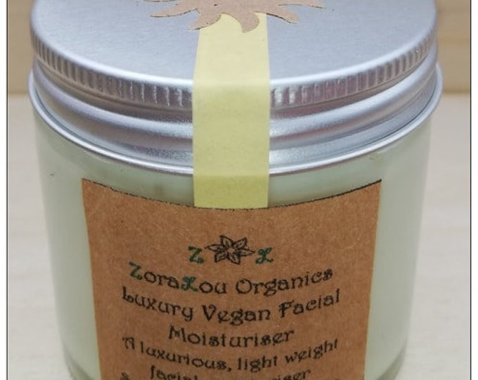 Organic facial moisturiser with Raw Cacao, Aloe Vera, Candellila Wax,Vitamin E oil, Calendula, Sunflower, Grapeseed & essential oils
