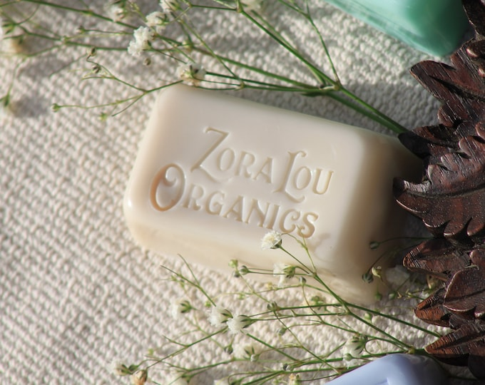 Organic shampoo and conditioning hair and body wash soap bar with musky, warming Patchouli, sweet, earthy Cedarwood and soothing Aloe Vera