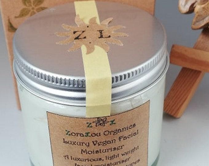 Organic facial moisturiser with Raw Cacao, Aloe Vera, Candellila Wax,Vitamin E oil, Calendula, Sunflower, Grapeseed & essential oils