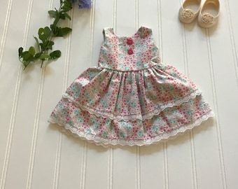 Pink and white dolll dress