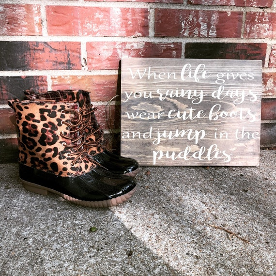 when life gives you rainy days wear cute boots and jump in the